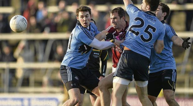 Dessie Dolan in action against Chris Guckian, left, and Cian Mullins, right