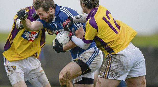 Billy Sheehan attempts to break away from Wexford duo Kevin O'Grady (left) and Ben Brosnan Ray McManus/SPORTSFILE