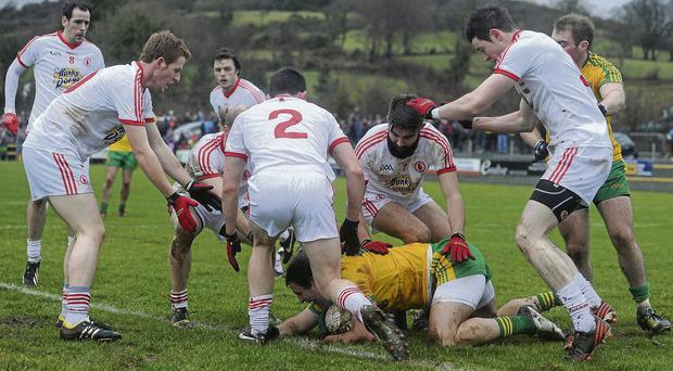Donegal's Michael Murphy is surrounded by Tyrone players (l-r) Niall McKenna, Danny McBride, Aidan McCrory, Tiernan McCann and Conor Clarke during their McKenna Cup match in Letterkenny Stephen McCarthy/SPORTSFILE