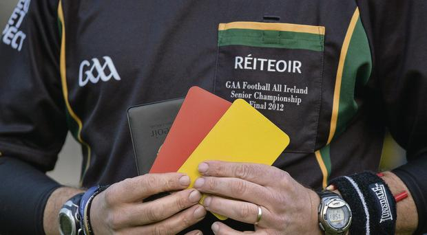 Referee Eddie Kinsella with his black book, red and yellow cards before the start of the game between Carlow and Longford Matt Browne/SPORTSFILE