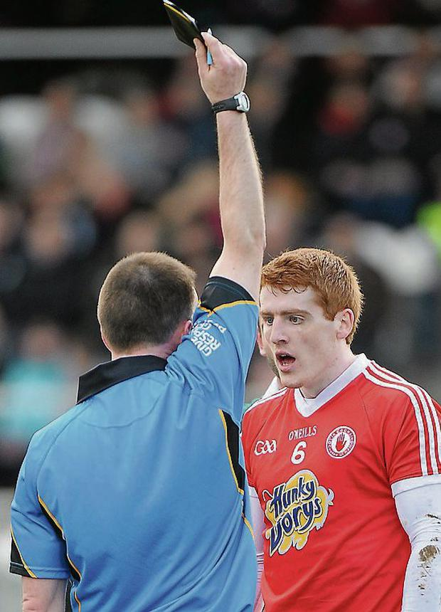 Tyrone's Peter Harte is shown a black card by referee Pádraig O'Sullivan