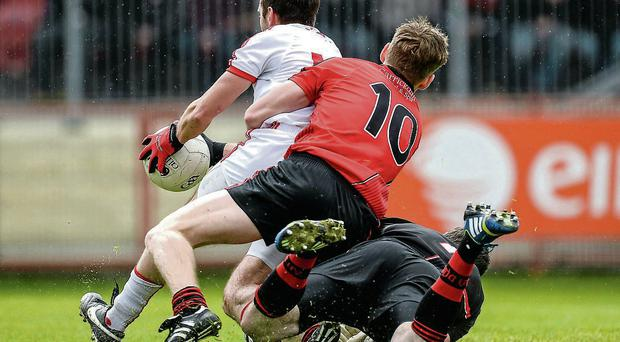 Down's Conor Maginn escaped without a black card for his first half foul on Mark Donnelly