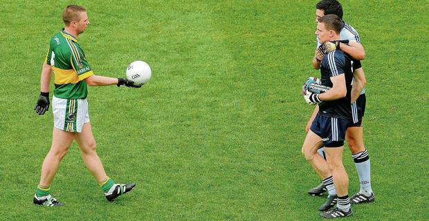 Kerry's Tomas O Se offers the match ball to Dublin's Stephen Cluxton after he kicked the winning point in the 2011 All-Ireland final