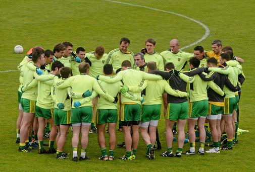 Donegal manager Jim McGuinness speaking to his players