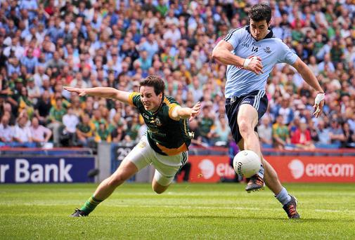 Michael Darragh Macauley of Dublin shoots goalwards despite the efforts of Meath's Eoghan Harrington during the 2012 Leinster final