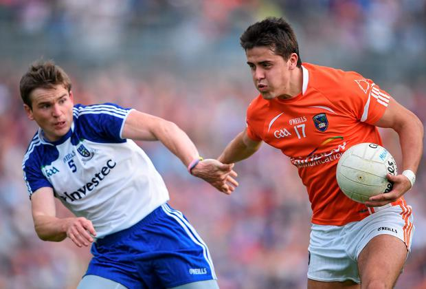 Stefan Campbell of Armagh, holds off the challenge of Dessie Mone