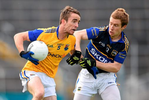 Colm Smyth, Longford, in action against Brian Fox, Tipperary