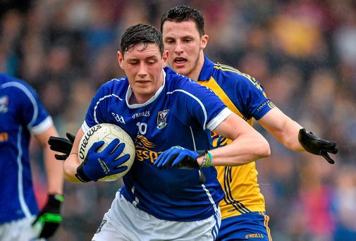 Michael Argue, Cavan, in action against Diarmuid Murtagh, Roscommon