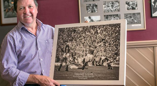 Former Tipperary hurler Pat Fox in his bar in Cashel with a print from the 1987 Munster final against Cork when Nicki English kicked the goal