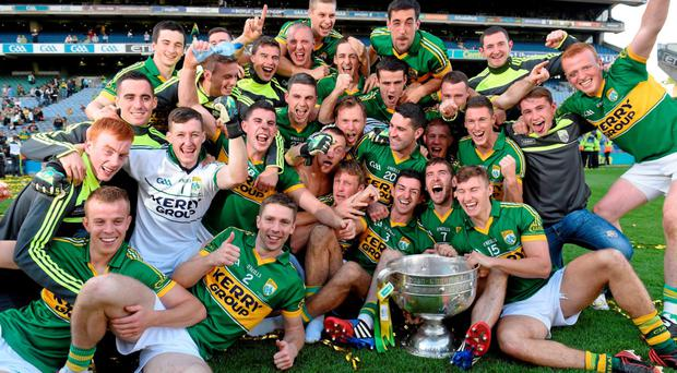 The Kerry team celebrate their All-Ireland victory over Donegal