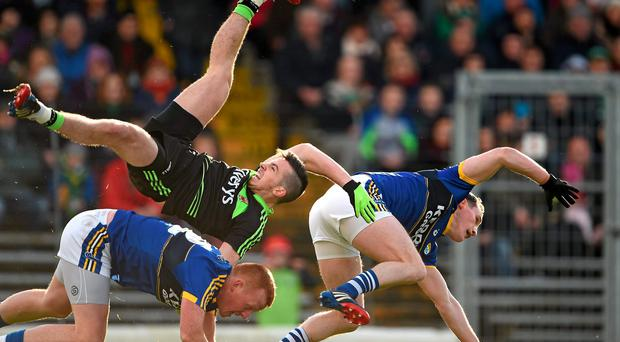 Evan Regan, Mayo, contests a high ball with Johnny Buckley, left, and Mark Griffin, Kerry. Regan was subsequently taken off on a stretcher as a result of the fall
