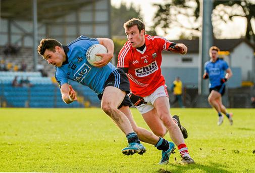 Dublin's Kevin McManamon in action against James Loughrey of Cork earlier this year.