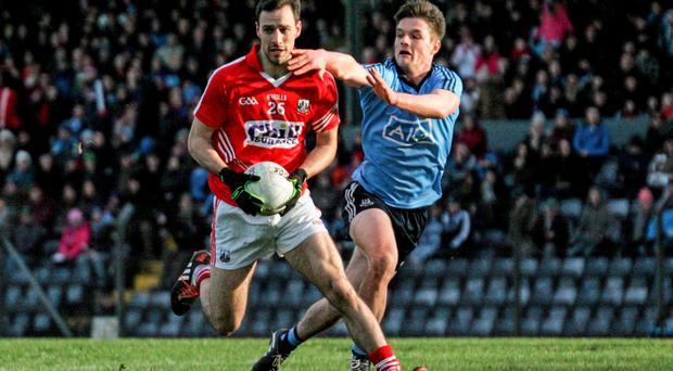 Kevin O'Driscoll, Cork, in action against Eric Lowndes, Dublin