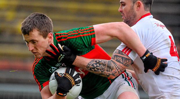 Cillian O'Connor, Mayo, in action against Cathal McCarron, Tyrone