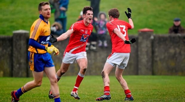 Louth's Declan Byrne and Ryan Burns, right, celebrate a late score against Clare