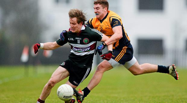 Ciaran McGeary, St Mary's College, Belfast, in action against Davy Byrne, DCU