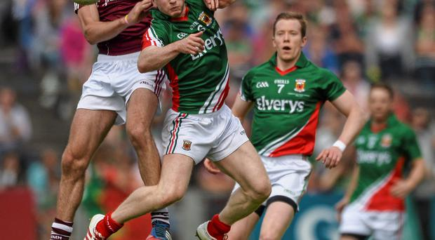 Galway's Fionan O'Curraoin challenges Mayo's Colm Boyle in last year's Connacht football final.