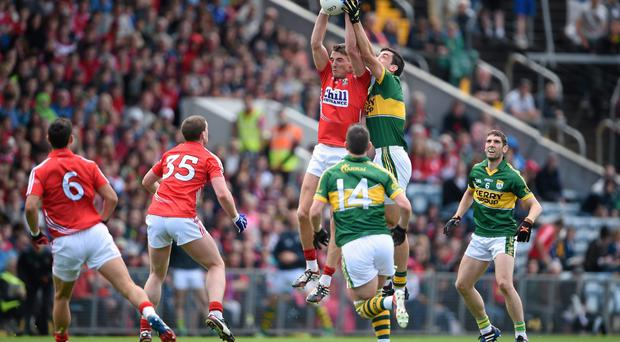 Cork's Aidan Walsh jumps with Kerry's Anthony Maher in last year's Munster final