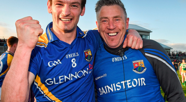 Longford's Barry Gilleran celebrates with manager Jack Sheedy
