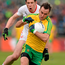Sean Cavanagh attempts to chase down Karl Lacey of Donegal during the Ulster SFC clash in Ballybofey SPORTSFILE