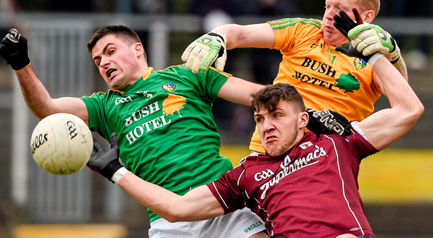 Galway's Damien Comer battles against Leitrim goalkeeper Cathal McCrann and full-back Ronan Gallagher during their Connacht SFC clash RAY McMANUS / SPORTSFILE