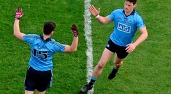 Diarmuid Connolly high-fives team-mate Bernard Brogan (L) after scoring Dublin's first goal past Longford goalkeeper Paddy McCollum on Sunday SPORTSFILE