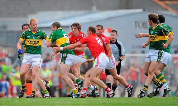 Tomas O Se has his shorts pulled by Alan O'Connor during the Munster SFC semi-final of 2010 in Killarney