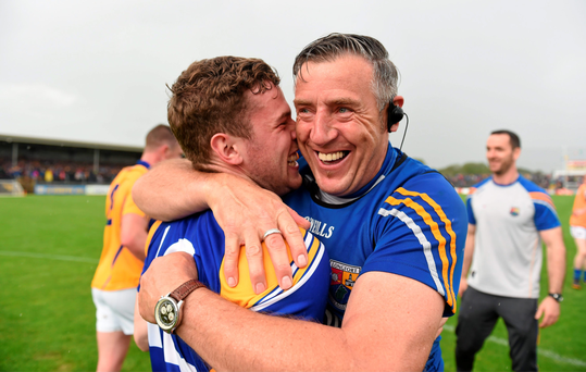 Longford manager Jack Sheedy celebrates his side's victory with Rory Connor