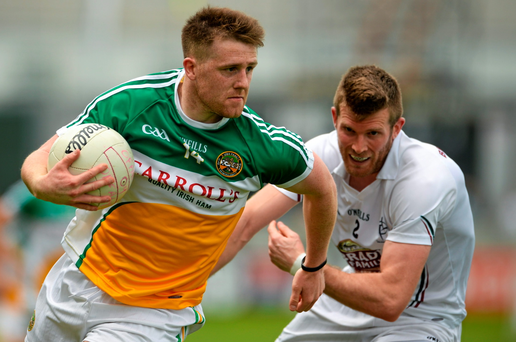 Kildare's Ciarán Fitzpatrick in action against Nigel Dunne of Offaly during their qualifier clash in Tullamore