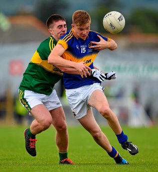 Brendan Martin, Tipperary, is dispossessed by Darren Brosnan, Kerry