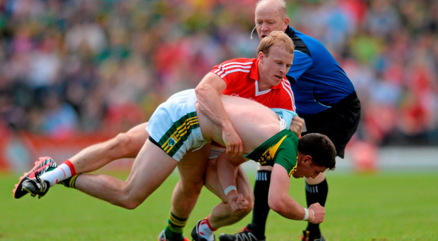 Cork's Michael Shields tussles with Kerry's Paul Geaney during the drawn Munster final