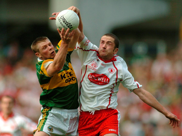 Tomas O Se, Kerry, in action against Stephen O'Neill, Tyrone