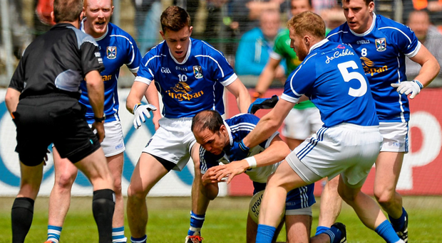 Monaghan's Paul Finlay is crowded out of it by four Cavan players during this year's Ulster Championship clash in Breffni Park Photo: Oliver McVeigh