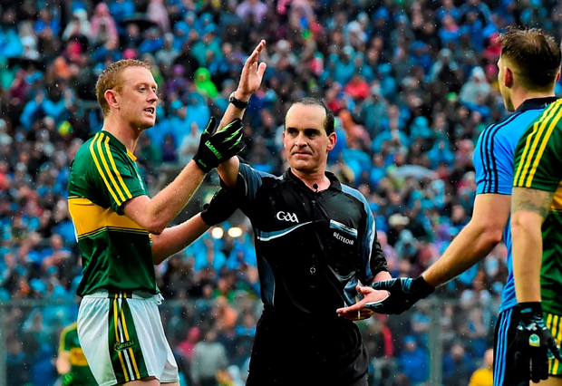Kerry forward Colm Cooper checks the time on the watch of David Coldrick during the closing minutes of this year's All-Ireland SFC final