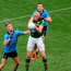 Kerry's Kieran Donaghy is double-teamed by Jonny Cooper and Denis Bastick at Croke Park last Sunday (SPORTSFILE)