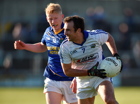 'Gareth Dillon of Laois tries to get past Wicklow's Stephen Kelly during the Leinster SFC clash in O'Moore Park last night.' Photo: Matt Browne