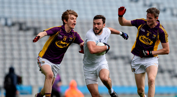 Kildare's Fergal Conway in action against Donal Shanley and Colm Kehoe in Croke Park last night. Photo: Dáire Brennan