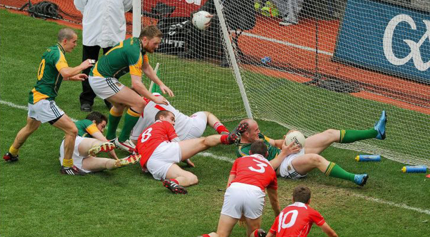 Joe Sheridan, above, bundles the ball to the net to break Louth hearts in 2010.