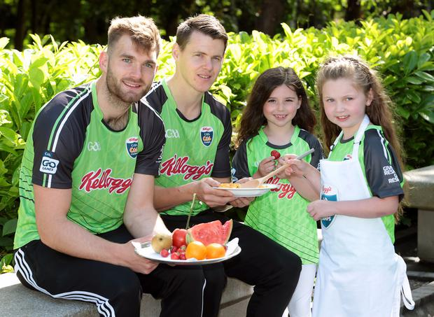 The Mayo ace with Kilkenny's TJ Reid, Sadie Grant (6) and Isabelle Doyle (6) at the Kellogg's Cúl Camps launch in Dublin yesterday