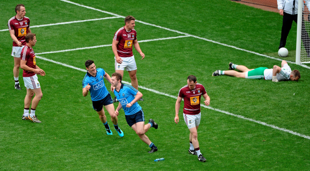 Jack McCaffrey celebrates after scoring Dublin's second goal against Westmeath in last year's Leinster final. Photo: Daire Brennan