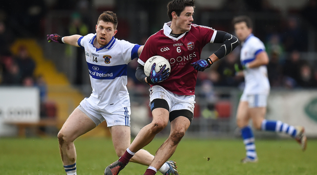 Chrissy McKaigue evades St Vincent's Mayo import Enda Varley during Slaughtneil's semi-final victory. Photo: Sportsfile