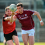 Down's Conor Maginn attempts to dispossess Galway's Shane Walsh in Newry. Photo: David Fitzgerald/Sportsfile