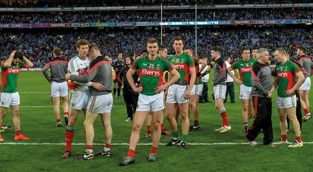 Dejected Mayo players and manager Stephen Rochford wait for the match presentation after losing to Dublin in last year's All-Ireland final replay. Photo: Sportsfile