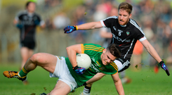 Meath's Donal Lenihan holds the ball under pressure from Keelan Cawley. Photo: Sportsfile