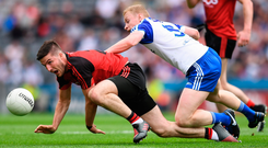 Niall McParland of Down attempts to block Colin Walshe's route to the ball during Monaghan's eight-point victory over the Mourne men at Croke Park yesterday. Photo: Sportsfile
