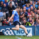 Lee Keegan tries to distract Dean Rock by throwing a GPS unit into his path at the climax of last week's All-Ireland final. Photo: Sportsfile