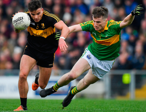 Micheál Burns of Dr Crokes shrugs off the challenge of South Kerry's Robert Wharton in Tralee yesterday. Photo: Sportsfile
