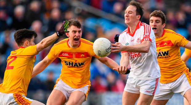 Alan Dillon of Ballintubber tries to get a pass away as he is closed down by Castlebar's Cian Costello, Barry Moran, and Ray O'Malley in MacHale Park. Photo: Sportsfile