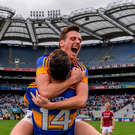 Conor Sweeney celebrates with Michael Quinlivan (No 14) after Tipperary's victory over Galway in the 2016 All-Ireland SFC quarter-final at Croke park. Below inset, Quinlivan on the charge. Photo: Sportsfile