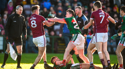 Galway's Paul Conroy (left) clashes with Cillian O'Connor of Mayo, with Aidan O'Shea on the ground, as referee Anthony Nolan (centre) looks on during the sides' league encounter Photo: Sportsfile